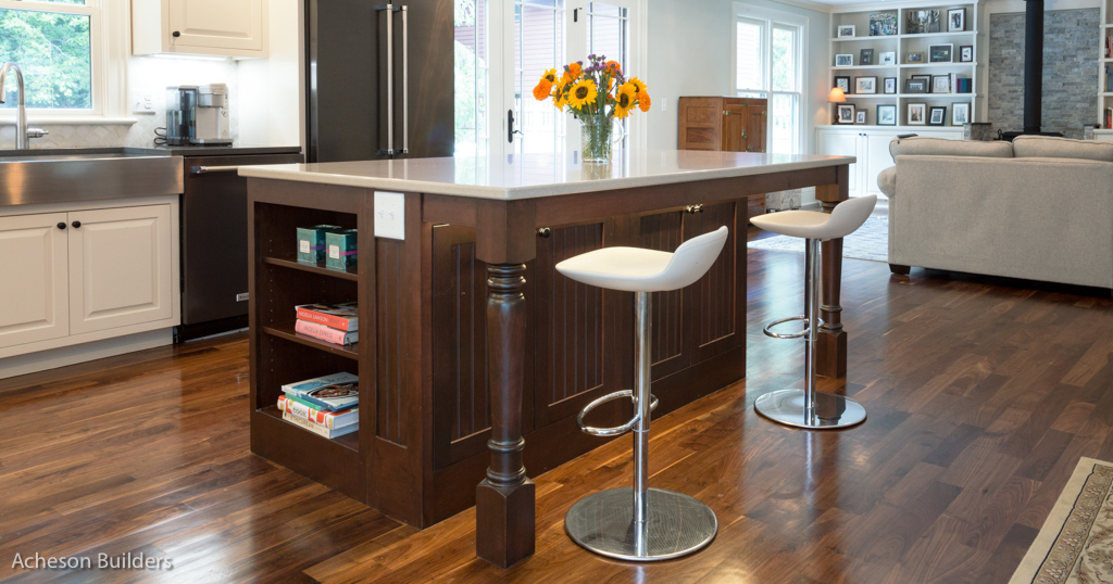 photo of kitchen island showing below-top storage open to living room after remodeling by acheson-builders-2nd-Street-Ann-Arbor-AFTER--13