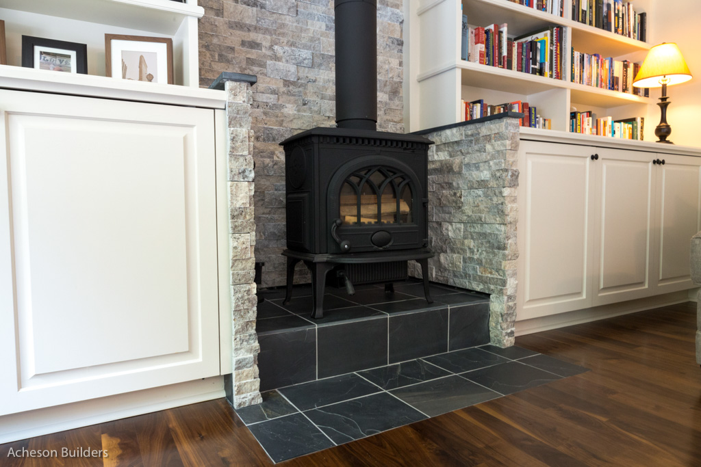 photo of fireplace with exposed smoke stack after remodeling by acheson-builders-2nd-Street-Ann-Arbor-AFTER--17