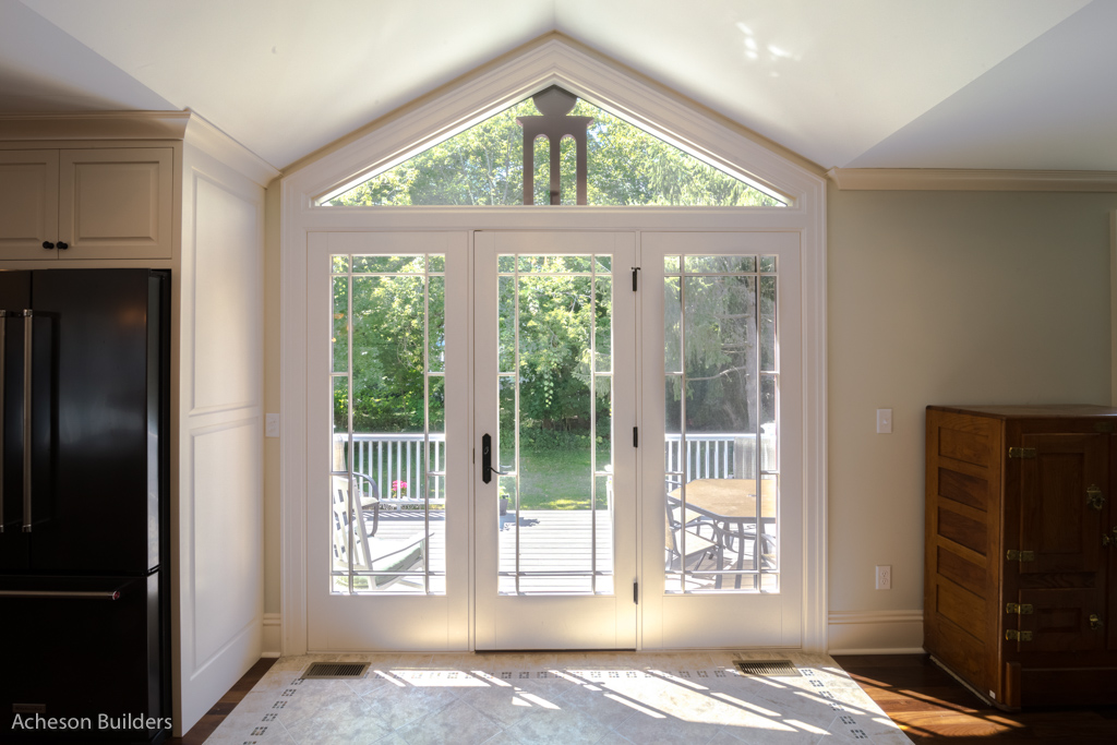 photo of glass full-pane door bordered by full-paned lights and glass transom after remodeling by acheson-builders-2nd-Street-Ann-Arbor-AFTER--19