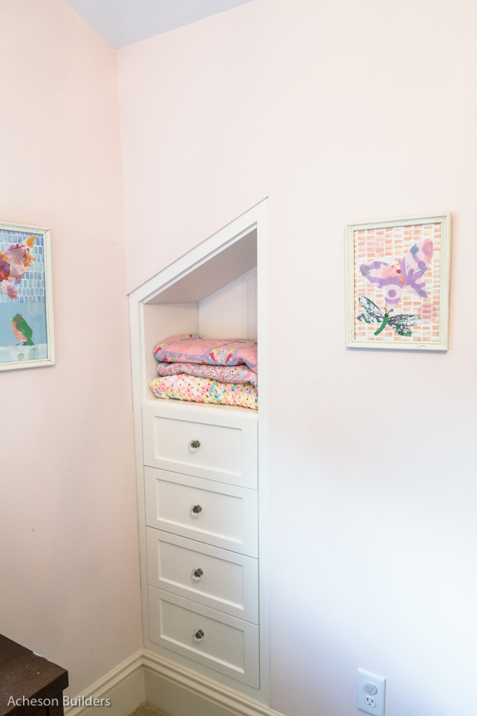 photo of built-in cubby and drawers in bedroom after remodeling by acheson-builders-2nd-Street-Ann-Arbor-AFTER--37