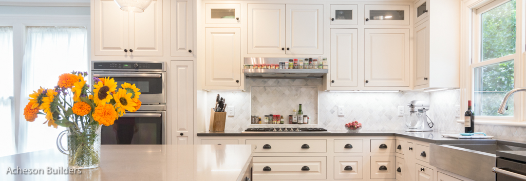photo of custom white cabinets with built-in stove after remodeling by acheson-builders-2nd-Street-Ann-Arbor-AFTER--4