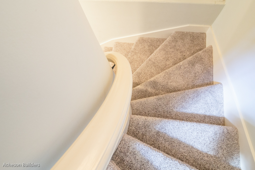 photo of curving stairway downstairs after remodeling by acheson-builders-2nd-Street-Ann-Arbor-AFTER--40
