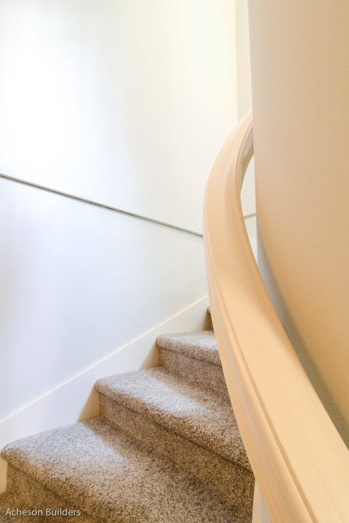 photo of curving stairway and custom curving handrail after remodeling by acheson-builders-2nd-Street-Ann-Arbor-AFTER--44
