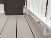 photo close of decking material and white fencing of deck after remodeling by acheson-builders-2nd-Street-Ann-Arbor-AFTER--53