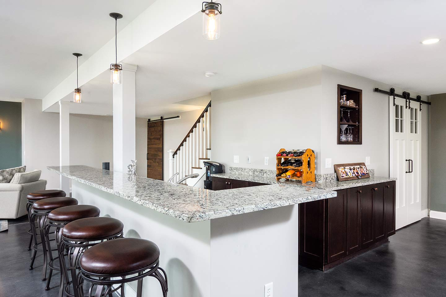 photo of remodeled basement snack bar entertainment area