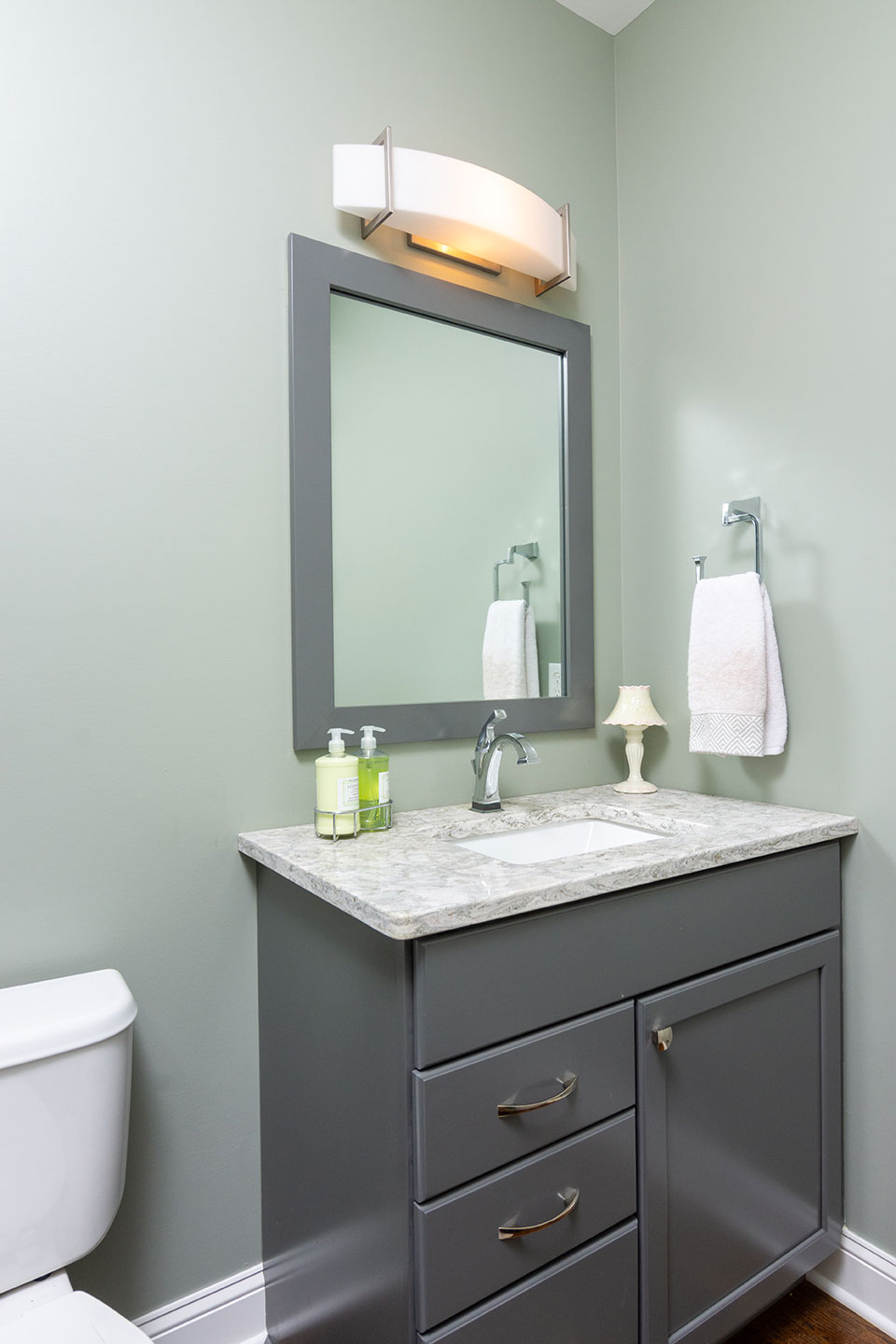 photo of bathroom sink with large mirror