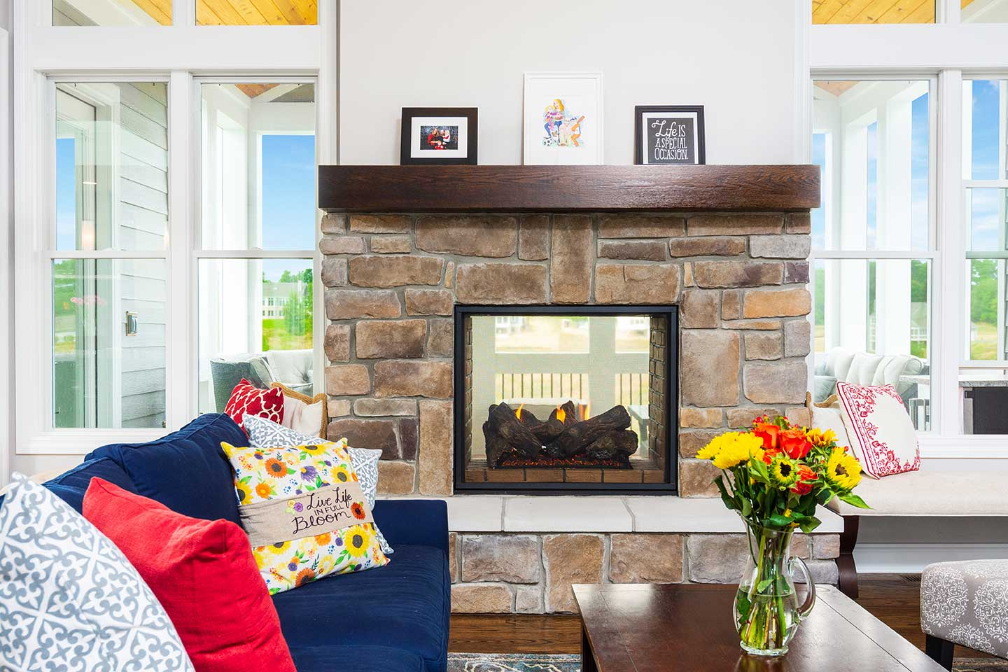 photo of fireplace and mantlepiece with glass panel showing fireplace opening onto indoor-outdoor second floor sun room