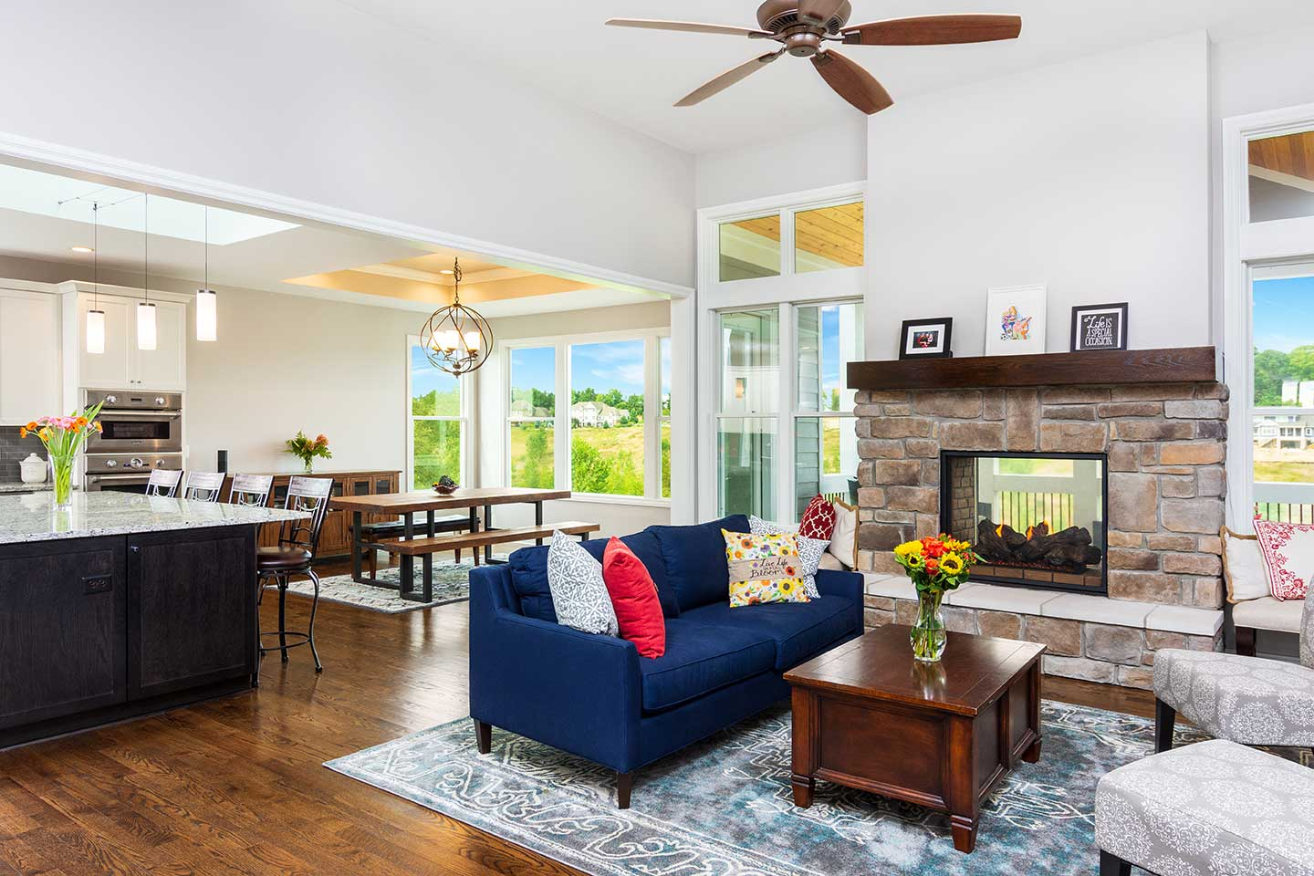 photo of furnished living room with fireplace sharing wall with indoor-outdoor sun room