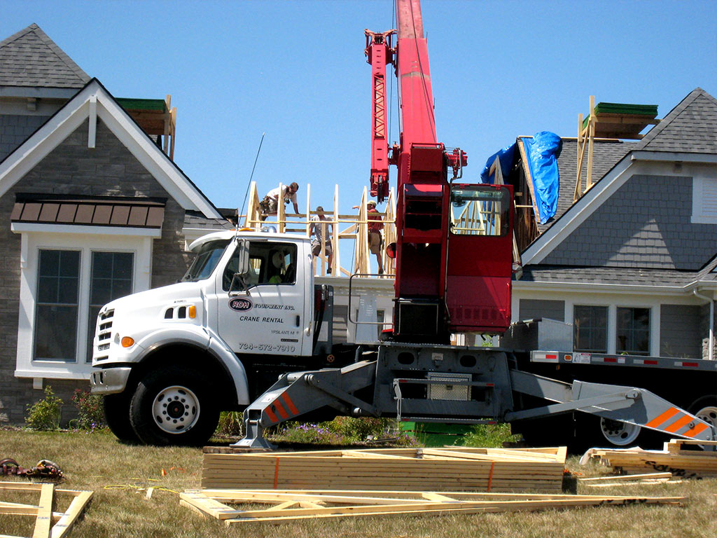 Construction crane in use during framing and roofing phase of restoration.