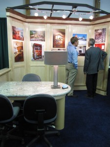 Jim Acheson, talking with a visitor at the 2010 HGL show
