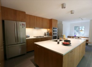 photo of custom kitchen cabinets and Island by Acheson Builders
